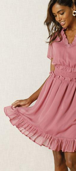 Roze jurk met smokwerk